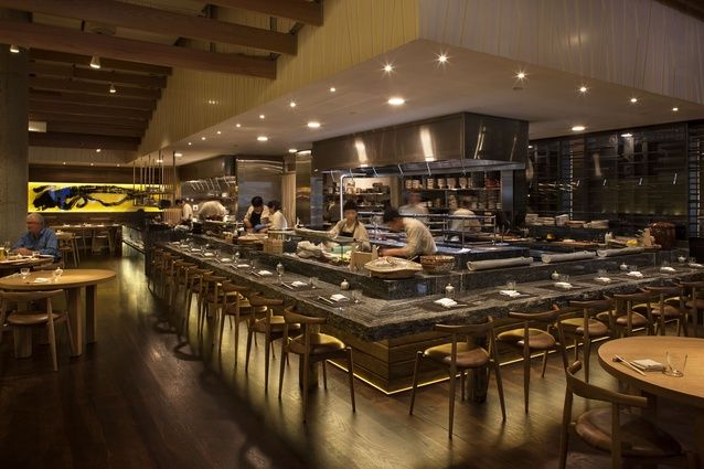 Masu restaurant, open-plan kitchen, natural-edge alpine ash granite counter and calligraphy dragon rice paper wall.