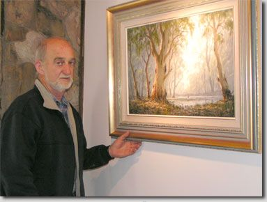 Ern Trembath with his landscape painting