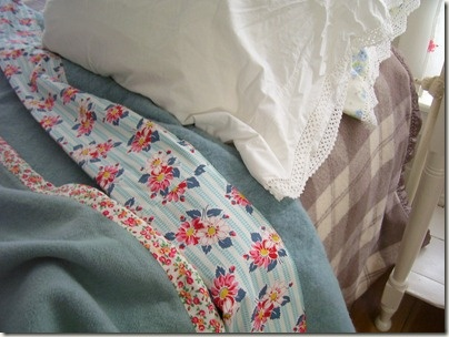 Wool blankets re-edged in cute calico, what a great way to soften up an often scratchy edge.