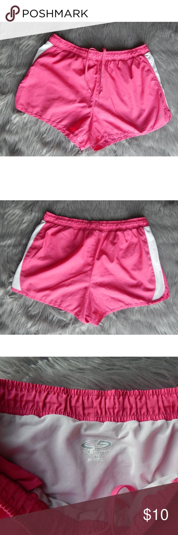 Champion Workout Shorts Shorts are in great condition: no rips, tears or holes, no stains Hot pink shorts with white stripe down each side Draw string waistband Original lining still in shorts Champion Shorts