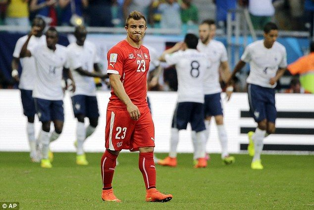 Down and out: Swiss star Xherdan Shaqiri's face tells the story as his side go 2-0 down after 18 minutes