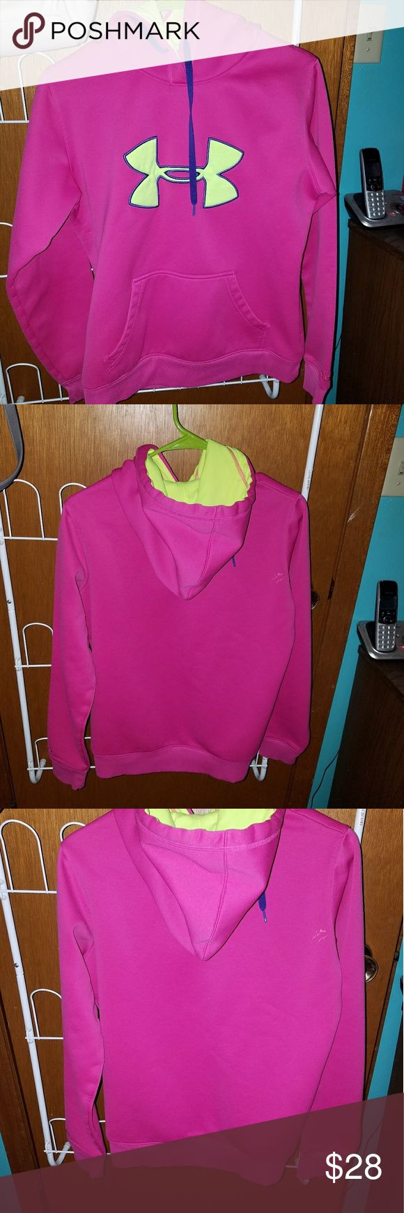 UA pink hoodie Hot pink, with yellow neon and purple. It is in like new condition except for a little stain (notice in pic. 3) size small. Please let me know if you have any question?  Thank you for stopping by ;) Under Armour Tops Sweatshirts & Hoodies