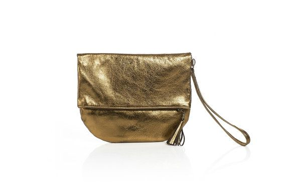 Metallic goldclutch with a removable hand strap and a small tassel • Metallic gold leather, not too flashy. Medium weight goatskin leather • Brass