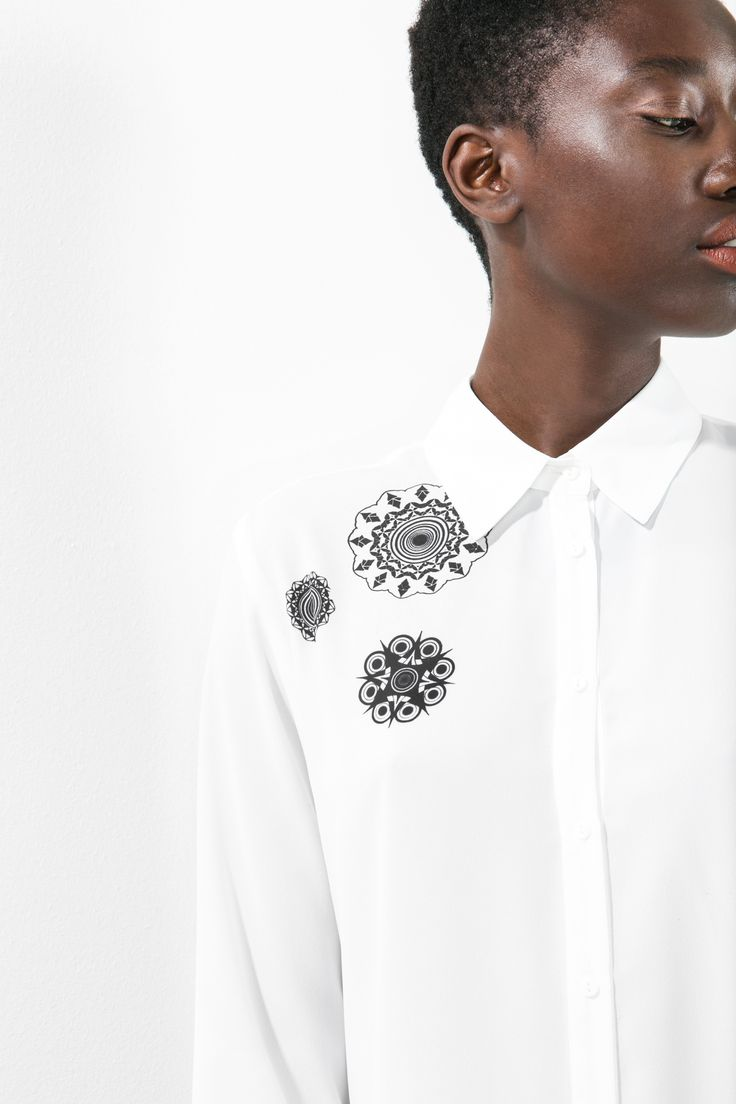 A fun twist on the classic white shirt: the kaleidoscopic details on this blouse will ensure no-one will give you the cold shoulder this season! Perfect for the office and wherever else life might take you...