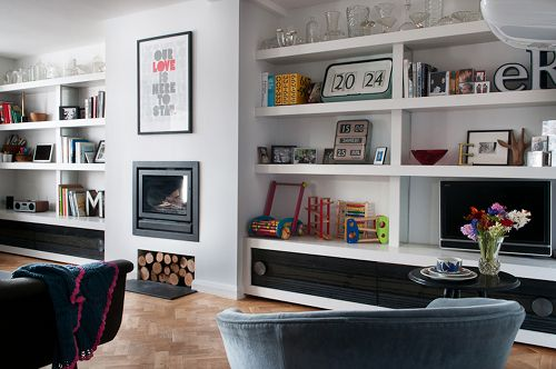 Open shelves are a great way to show off personal displays. Love the built in woodburner. Designed by Edwina and Marc Boase