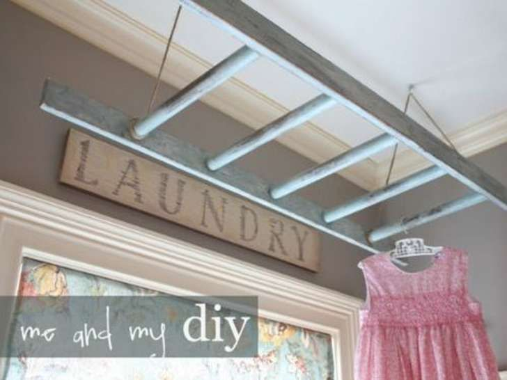 This would be perfect to hang clothes on to dry. Paint the ladder a bright color to accent the laundry room.