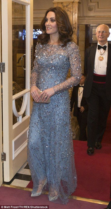 Kate dazzled in a full-length, light blue gown which was embellished with crystals and sequins which caught the light