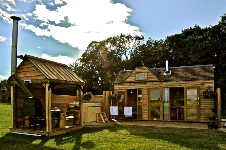 A tiny house with a wood-fired hot tub and veranda in Southam, Warwickshire, England.