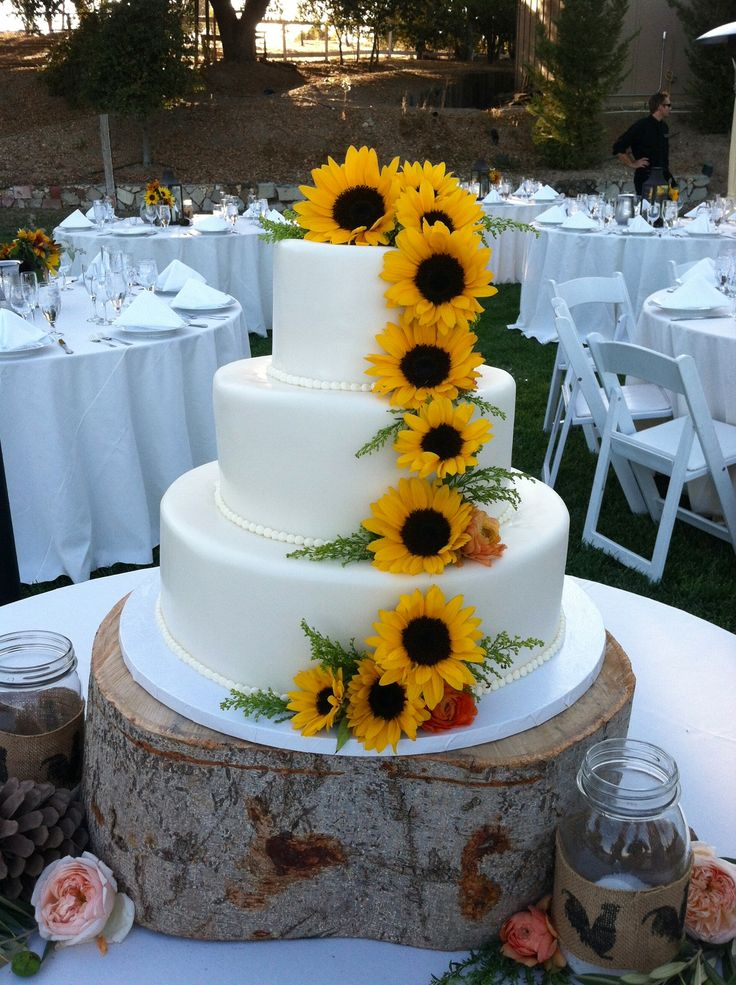 Adorned with sunflowers grown by the Bride & Groom! <3
