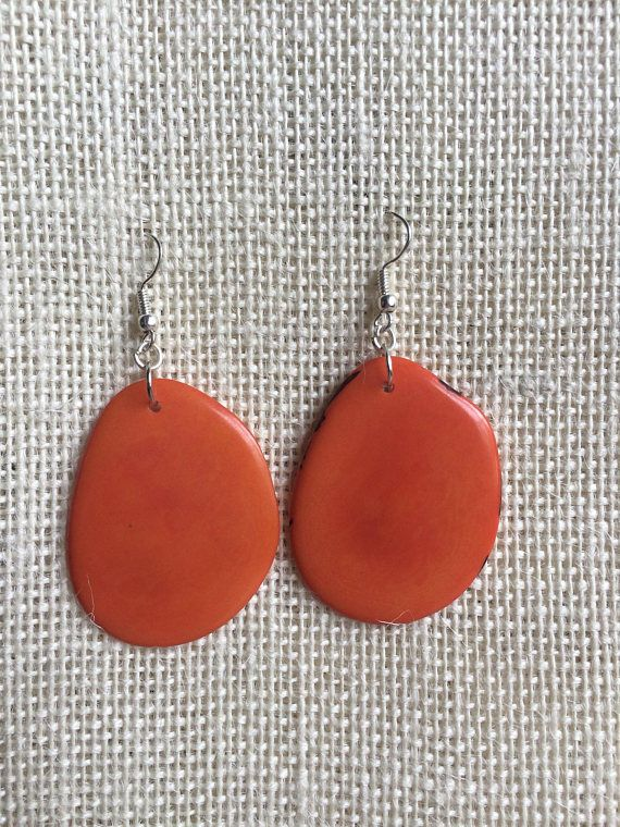 Big tagua earrings. Orange statement earrings. Tagua but jewelry