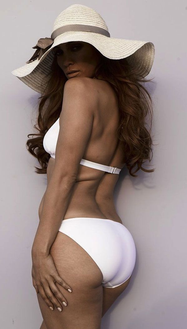 JLo unretouched . . . so she has rolls! LOL how encouraging. And messed up that we expect and are expected to have her figure, but no flaws