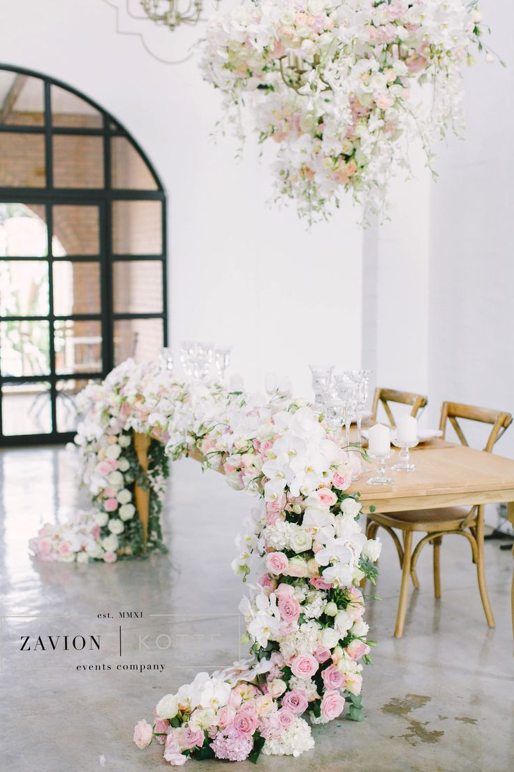 Bridal table, floral runner, flower runner, hanging arrangement, orchids, roses, pink, green, white. Raw wooden tables, wedding day, bride, flowers and decor décor . This table was truly magical and perfect for a princess! royal wedding
