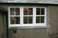 upvc white vertical sliding windows with face fret bars