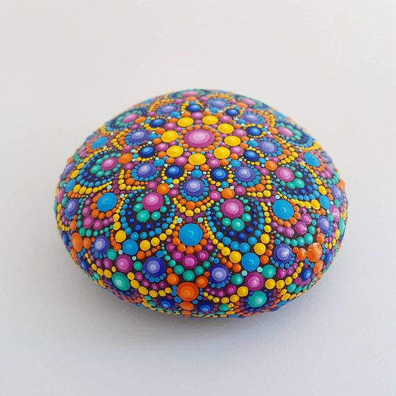 Original hand painted happy mandala stone. Large one, feels good in the hand, pleasant to touch because of 3D painting. I especially recommend to use this one as meditation stone. This is absolutely natural stone without shaping and polishing from human side which was found in the wild