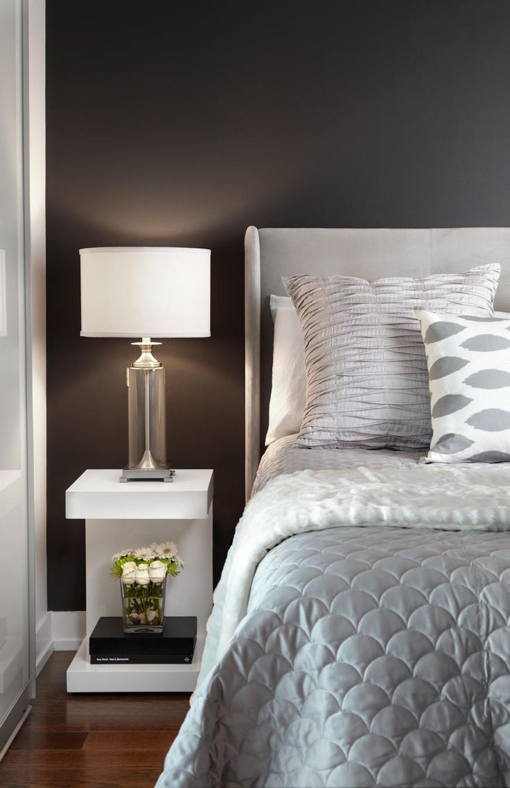 Love nightstand and gray bedding!