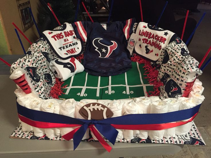 "My first attempt at making a ""diaper cake"" HOUSTON TEXANS STADIUM.. (Texans themed shower) -Yvonne G"