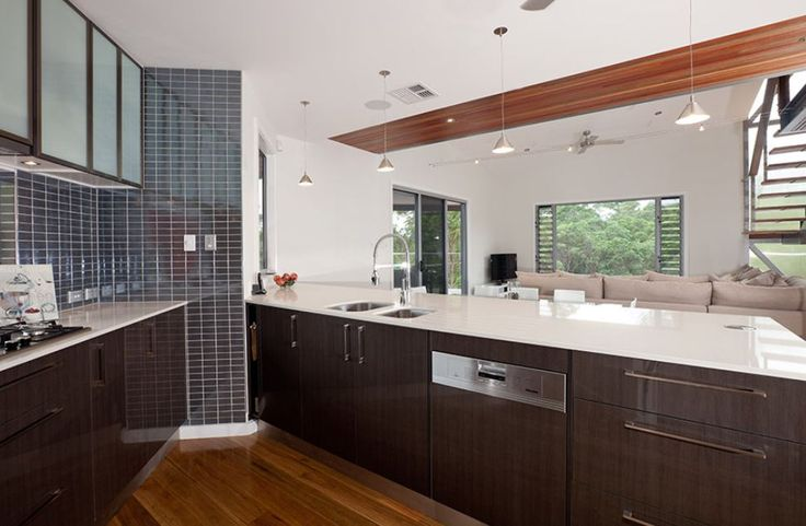 Imperial Kitchens V-shaped dark brown kitchen, opaque glass door in top cabinets