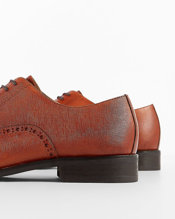 $76.80 EXPRESS Cap toe dress shoes SOLD by EXPRESS - affiliate - 40%OFF - Saffiano Leather Cap Brogue Oxford Dress Shoes | Express The definitive shoe to bring out your sophisticated side. Genuine textured leather with broguing details makes this rich style next-level sharp, while a cushioned insole and adjustable laces keep you grounded in comfort. ONLINE EXCLUSIVE -