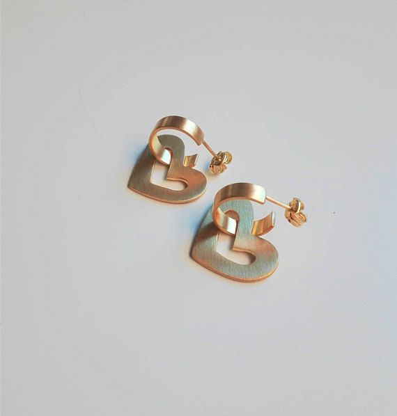 * Heart Hoop Earrings - Valentines Day Gift For Her * * Material : 24k Gold Plated Brass * * Hoop Diameter: 0.47 / 1,2cm * * Heart Dimensions: 0.74 x 0.94 / 1,9 x 2,4cm * * Post: Sterling Silver Posts with matching Ear Nuts ** HOW TO KEEP YOUR PLATED JEWELRY HAPPY ** Gold