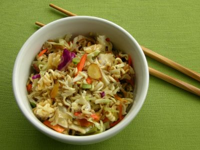 A side dish made with ramen noodles, cole slaw mix, almonds, sunflower seeds, and an oriental vinaigrette.