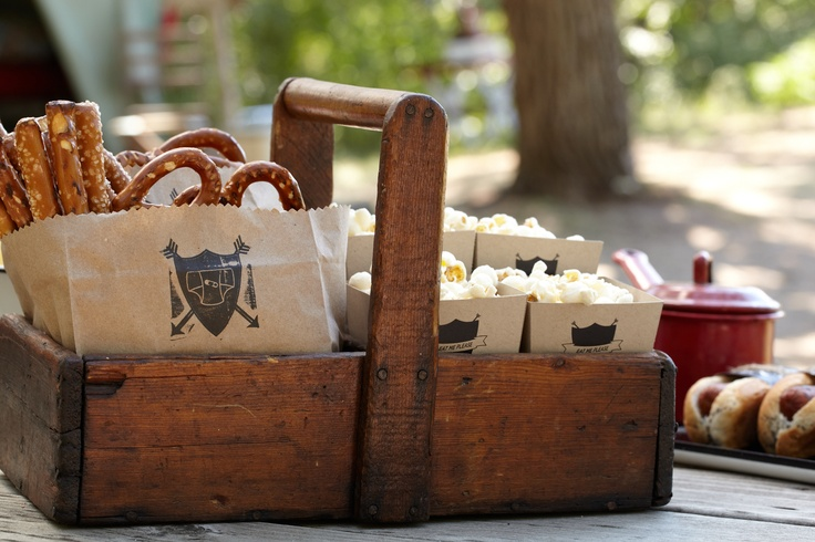 Pretzel and Popcorn Snacks. Give out salty snacks to baby shower guests in vintage wooden picnic baskets.