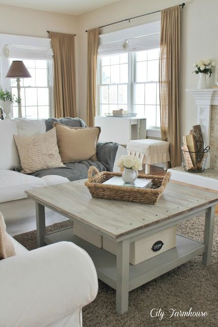 I love the warm neutral colors in this room. The storage in this living room is nice-especially her use of baskets
