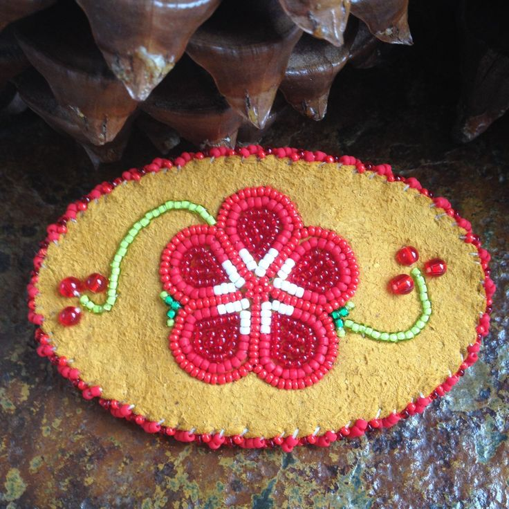 A personal favorite from my Etsy shop https://www.etsy.com/listing/277248646/athabascan-flower-barrette