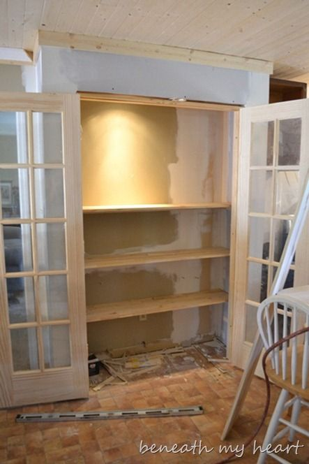 upstairs - shallow built in bookcase with doors