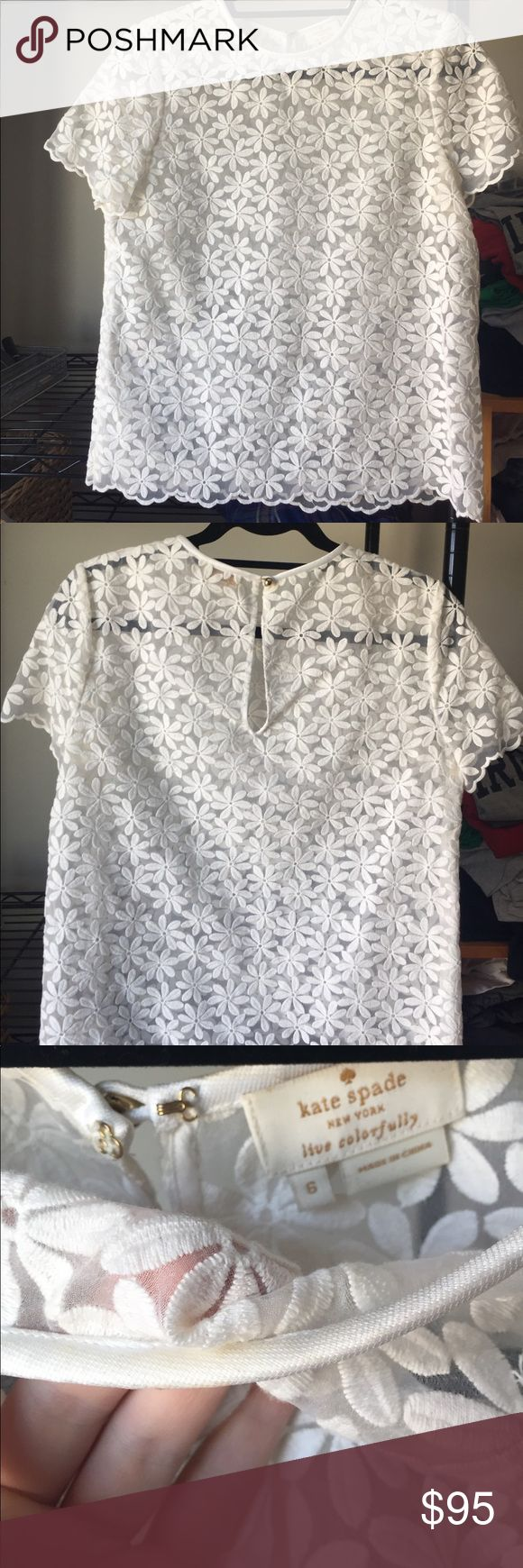 Kate Spade daisy blouse Darling Kate Spade daisy blouse. Keyhole back with gold button. See thru- would be sexy with a fun bra  underneath or pair with a nude cami to make it more modest. Size 6 but fits like a 4.  Slight discoloration on inside of color but would probably come out with dry cleaning (not visible from the outside). Worn 1-2 times. kate spade Tops Blouses