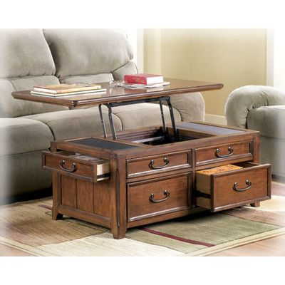 Signature Design By Ashley Woolwich Trunk Coffee Table With Lift Top