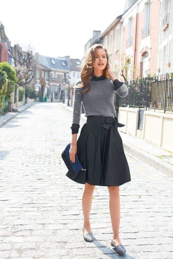 Spring style   Grey sweater over charcoal shirt, matching midi skirt, flats and a clutch