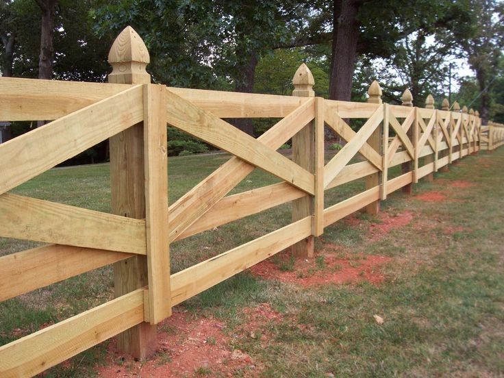 Custom wood crossbuck horse fence design by Mossy Oak Fence Company