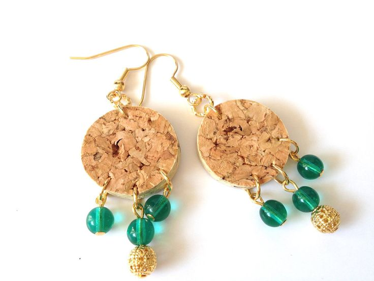Turn used corks into one-of-a-kind jewelry. Chop them up into thinner slices and add beads to dress them up. You can even hollow them out and insert a bead for a different look.  Source: Etsy user SimplyMarch