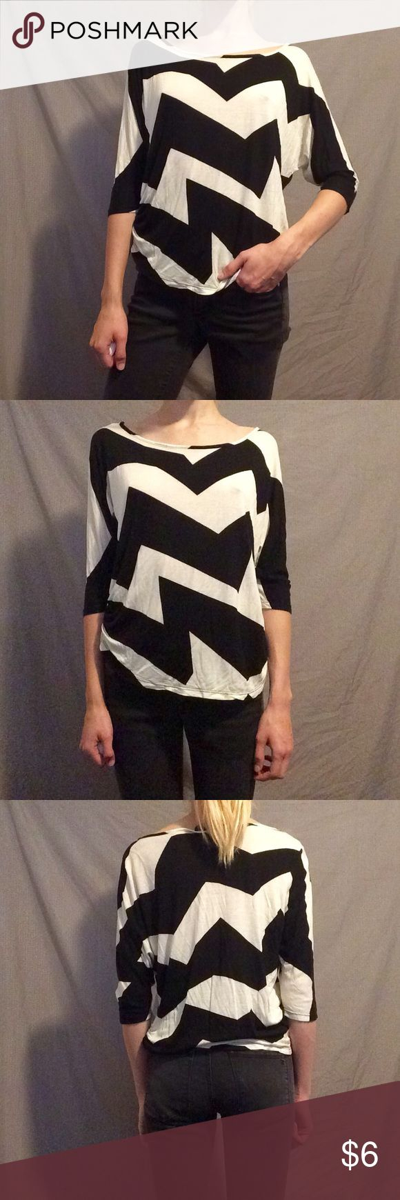 Black/White Crooked Chevron Blouse Stylish black/white half sleeve blouse with crooked chevron pattern Annabelle Tops Blouses
