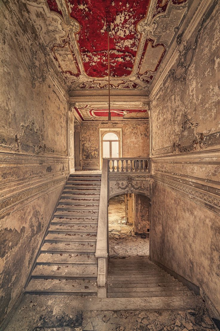 I love the red on the roof, abandoned stairs~Matthias Haker