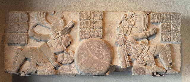 Ancient Maya ball game players face off in this stone carving