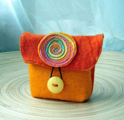 orange felt bag with huge button and motive
