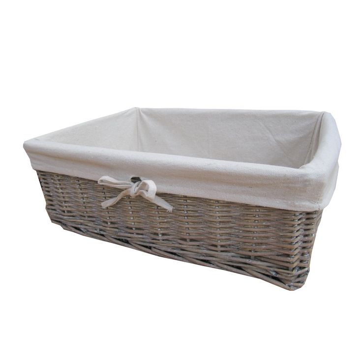 Wicker basket with fabric lining. Stuff with necessities and niceties for bridesmaids (large basket or two for all not one small one each)