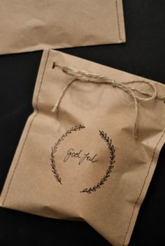 Brown Kraft paper bag gift wrapping. You could make these with paper lunch bags or sew a sheet of Kraft paper into a bag shape. Finish with pretty hand stamped image. #giftwrapping #diy | Run Wild Horses