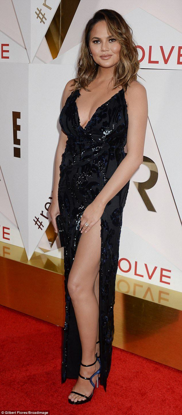 Photos: Chrissy Teigen Stuns As She Goes Bra-less In Thigh High Slit Dress