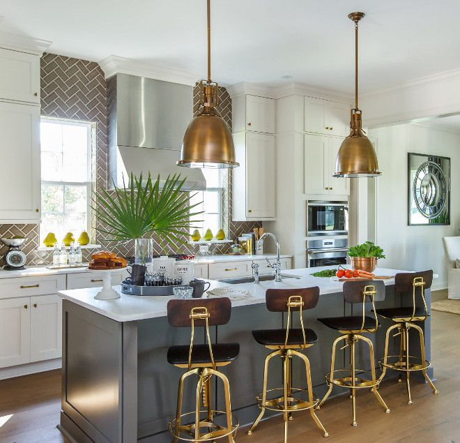 Sherwin Williams Urbane Bronze SW 7048. Countertop: Natural Honed Marble (Mystery White – color). Cabinet color Shoji White SW7042