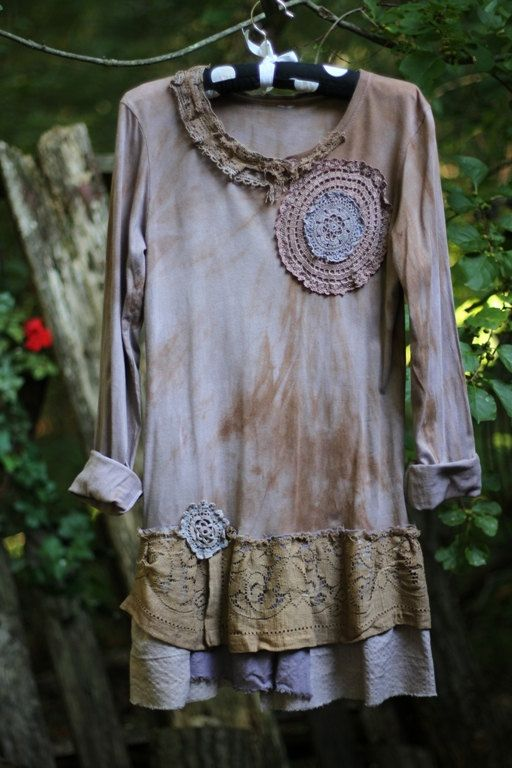 Antique lace sewn around collar. - Two large vintage hand-dyed doilies sewn near collar, matching fabric of the tunic. - Unique and interesting layers at bottom of tunic, one made from dyed vintage lace from vintage hand dyed tablecloth. -Hand-dyed blue doily is sewn by the trim.