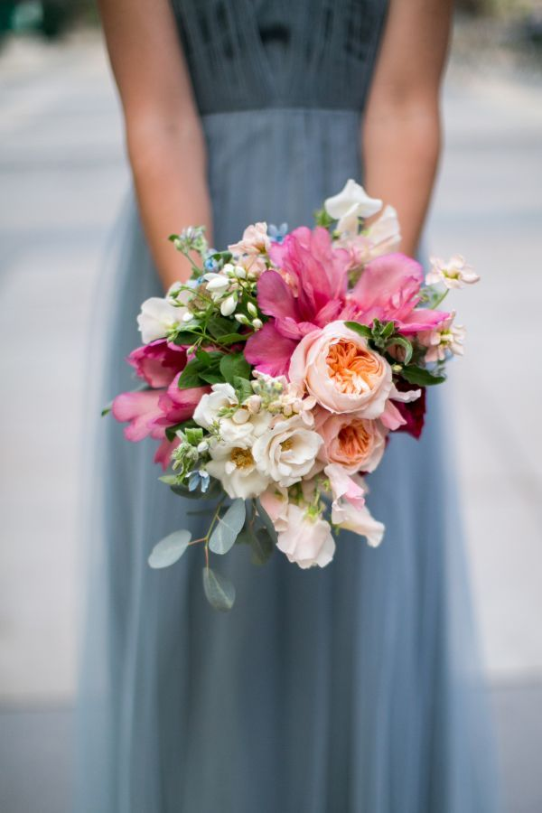 Colorful parrot tulip, peony, ranunculus, and rose wedding bouquet: http://www.stylemepretty.com/2016/11/18/bryant-park-grill-wedding/ Photography: Craig Paulson - http://cpaulson.com/