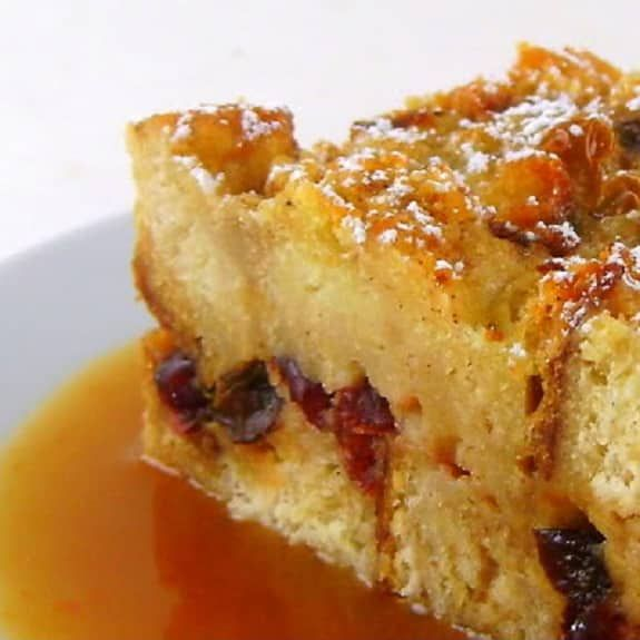 Cranberry-orange bread pudding. Delicious dessert with berries and orange baked in the oven.