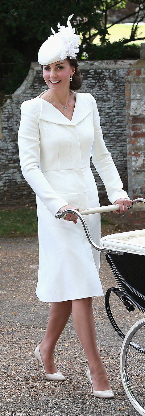Duchess of Cambridge pushes Princess Charlotte as they arrive at her christening...