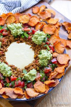 Paleo Nachos with Sweet Potato Chips and Dairy Free Cheese Sauce - low carb, gluten free, primal and clean eating recipe. Via http://eatdrinkpaleo.com.au/paleo-nachos-with-sweet-potato-chips/
