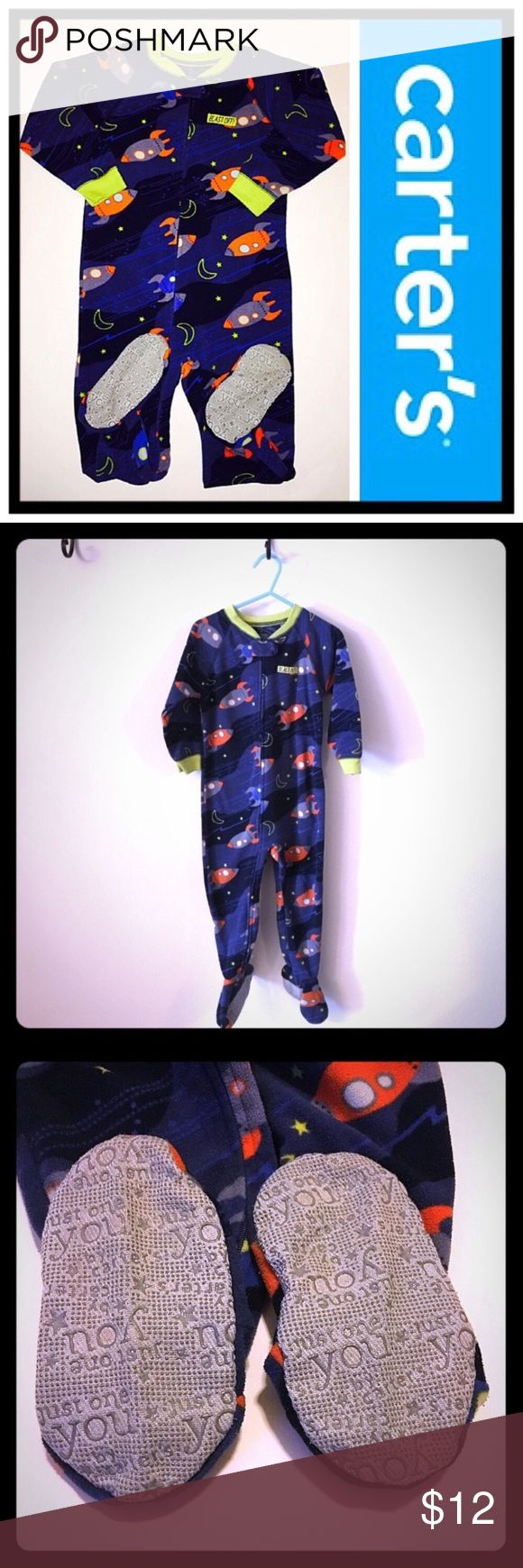"Carter's 2T Rocket Fleece Footed Pajamas 📦Same day shipping (excluding Sun/holidays or orders placed after P.O. Closed) ❤️Save on shipping: Add all of your ""likes"" to a bundle and submit an offer  Your little space explorer will be snuggly & styling in these fleece footed pjs. 🚀 Grips on feet to help to avoid slipping. They zip all the way down for easy on/off with a button closure at the top of the zipper. No holes or stains. Normal wear from use. Smoke/pet free home. 12"" chest, 11.5""…"