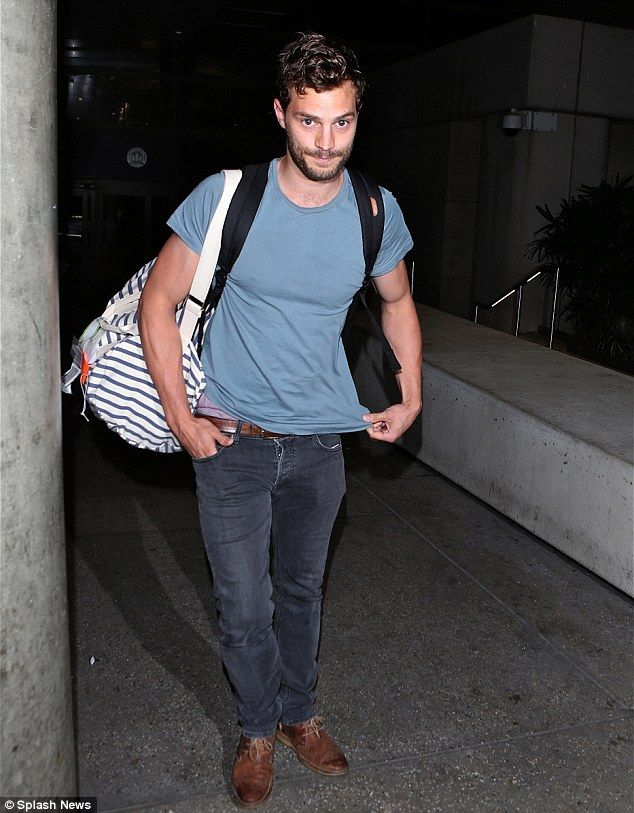 Just landed: Jamie, who plays Christian Grey in the movie, arrived in LA at the same time as Dakota