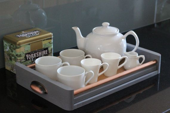 A hand-crafted solid-wood tray ideal for use as a tea tray or serving tray, with beautiful copper handles and copper detailing. The Tray is lined with cork, which looks stunning alongside the copper and wood, but also provides an impermeable heat resistant surface, with great abrasion resistance.