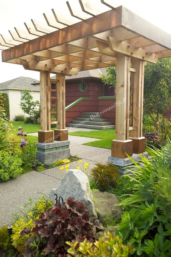 The entrance to this south and west facing organic garden in Seattle is through this distinctive entry arbor.